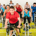 Fitness instructor with spinning class Stock Photos
