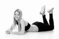 Fitness lying woman portrait isolated on white background. Smili Royalty Free Stock Photo