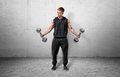 Fitness man lifting a dumbbell by both hands. Royalty Free Stock Photo