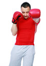 Fitness man punching with red boxing gloves isolated on white background Stock Images