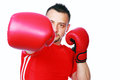 Fitness man punching with red boxing gloves isolated on white background Stock Photography