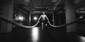 Fitness man working out with battle ropes at a gym Royalty Free Stock Photo