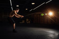 Fitness man workout with battle ropes at gym. training exercise fitted body in club. Torso. Royalty Free Stock Photo