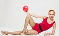 Fitness model with ball Royalty Free Stock Image