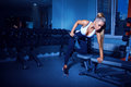 Fitness model doing exercises with dumbbell in gym Royalty Free Stock Image