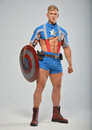 Fitness model in superhero costume male Stock Photography