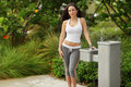 Fitness model by a water fountain Stock Image