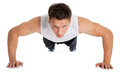 Fitness muscle model guy making push ups exercise young sport man over white background Stock Photo