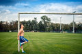 Fitness player working out on football field. Cross fit training outdoors on a summer day. Royalty Free Stock Photo