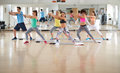 Fitness practicing group with resistant rubber Royalty Free Stock Photo