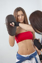 Fitness punching training women with boxing mitts Royalty Free Stock Images
