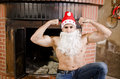 Fitness santa in chimney posing strong for health happy new year Stock Photo