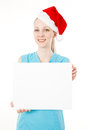 Fitness santa woman holds blank sign Royalty Free Stock Images
