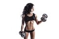 Fitness sexy young woman in sport wear with perfect fitness body training with dumbbells