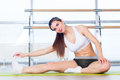 Fitness sport training and people concept happy young woman stretching before running in gym Stock Photos