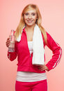 Fitness sport woman white towel on shoulders studio shot portrait smiling happy female sporty girl with and bottle of water pink Stock Photo