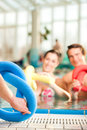 Fitness sports gymnastics under water in swimming pool a young couple man and woman doing and or aerobics or spa with swim Stock Image