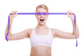 Fitness sporty girl covering her eyes with measuring tape isolated body care diet weight loss concept woman covered violet face Royalty Free Stock Image