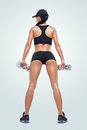 Fitness sporty woman in training pumping up muscles with dumbbells Royalty Free Stock Photo