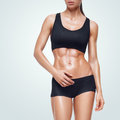 Fitness sporty woman walking on white background strong abs showing Royalty Free Stock Image
