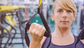 Fitness strap in the hand of woman training Royalty Free Stock Photo