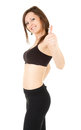 Fitness teenage girl with thumb up Stock Photography