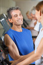 Fitness trainer flirting with woman Royalty Free Stock Photo