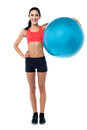 Fitness trainer holding pilates ball are you ready to workout with pilate Royalty Free Stock Photos