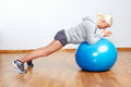 Fitness trainer pilates ball workout woman in gym Royalty Free Stock Photos