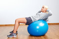 Fitness trainer pilates ball workout woman in gym Stock Photo