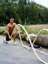Fitness with training ropes photo of a muscular asian man outdoors working out Royalty Free Stock Photo