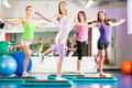 Fitness - Training and workout in gym Stock Photo