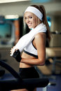 Fitness on a treadmill smiling athletic woman resting Stock Images