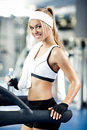 Fitness on a treadmill smiling athletic woman resting Stock Image
