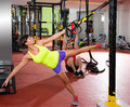 Fitness trx training exercises at gym woman and man crossfit women dip rings men workout Stock Photos