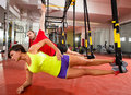 Fitness trx training exercises at gym woman and man crossfit women men side push up workout Stock Images