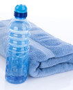 Fitness water and towel bottle to hydrate after workout sweat Stock Image