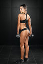 Fitness Woman With Barbells On...