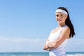 Fitness woman beach sportive young with arms crossed on Royalty Free Stock Photography