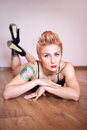 Fitness woman with a beautiful body and tattoo. Royalty Free Stock Photo