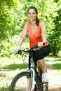Fitness woman on bicycle Royalty Free Stock Photo