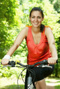 Fitness woman on bicycle Stock Photo