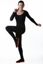 Fitness woman in black sports clothing doing exercises aerobics shot in studio isolated on white Stock Images