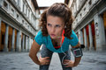 Fitness woman catching breathe near uffizi gallery in florence italy Stock Photography