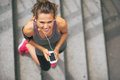 Fitness woman with cell phone outdoors in city Royalty Free Stock Photo
