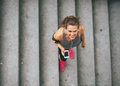 Fitness woman with cell phone outdoors Royalty Free Stock Photo