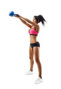 Fitness woman do kettlebell swing and kettlebell snatch Royalty Free Stock Photo