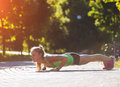 Fitness woman doing exercises during outdoor cross training workout in sunny morning Royalty Free Stock Photo