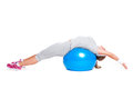 Fitness woman doing flexibility exercise on ball Stock Photos