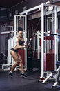Fitness woman doing triceps exercises in the gym Royalty Free Stock Photo